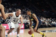Michigan's Trey Burke. Drives to the basket against Penn State Stock Image