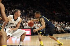 Michigan's Trey Burke. Drives to the basket against Penn State Stock Images