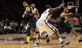 Michigan's #3 Trey Burke. Drives to the basket against Penn State Stock Photos