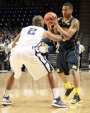Michigan's #3 Trey Burke. Looks to make a move Royalty Free Stock Images