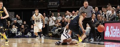 Michigan's Trey Burke strips Penn State's D.J. Newbill Stock Images