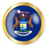 Michigan Flag Button. Michigan state flag button with a gold metal circular border over a white background Stock Images
