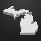Michigan State map in gray on a black background 3d Royalty Free Stock Photo
