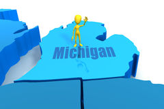 Michigan state outline with yellow stick figure Stock Photos