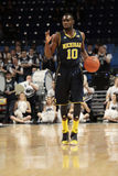 Michigan vakt Tim Hardaway jr. nr. 10 Royaltyfri Fotografi