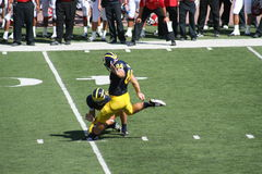Michigan Wolverine Kicker. K.C. Lopata kicks a 50 yard field goal Stock Photos