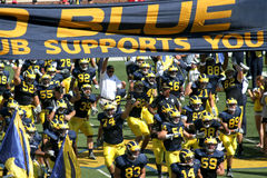 Michigan Wolverines. Football team rushing into the Big House before a game Royalty Free Stock Image