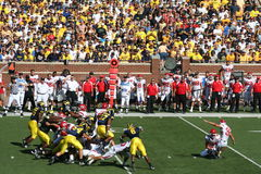 Michigan Wolverines Field Goal Block. The Michigan Wolverines attempt to block a field goal during a game Royalty Free Stock Photos