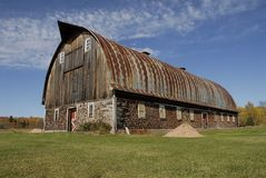 Michigans largest corwood barn. This barn is located in the western end of Michigans Upper Peninsula. The wall are made of logs 16 long mortared togater to form Royalty Free Stock Photo
