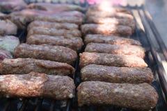 Mici na grillu (romanian mięsne piłki) Fotografia Stock