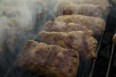 "Mici - romanian summer traditionaly food. Tasty meat ""sausages"" called ""mici"". Well known in Romania especially on summer picnic Stock Photography"