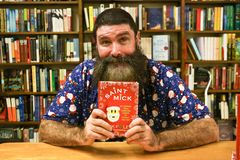 Mick Foley. NEW YORK-OCT 19: Mick Foley signs copies of his book, `Saint Mick: My Journey From Hardcore Legend to Santa`s Jolly Elf` at Book Revue on October 19 Royalty Free Stock Photography
