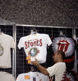 MICK JAGGER AND THE ROLLING STONES. A merchant prepares to sell tour T-shirtst during the Rolling Stones' Steel Wheels Tour in Washington, D.C., on Thursday Royalty Free Stock Photos