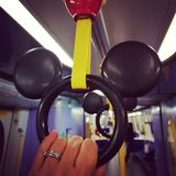 Mickey Handrail. Mickey Mouse handrail on disney train stock photos