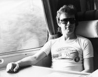 Mickey Jupp. British rock and roll singer, sits on board a train in Edinburgh, Scotland on October 27, 1978 Royalty Free Stock Image