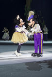 Mickey and Minnie Asking to Dance. GREEN BAY, WI - MARCH 10: Mickey asking Minnie Mouse to dance purple outfits and skates at the Disney on Ice Treasure Trove Royalty Free Stock Image