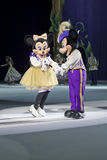 Mickey and Minnie before the dance. GREEN BAY, WI - MARCH 10: Mickey and Minnie Mouse in purple outfits and skates getting ready to dance at the Disney on Ice Stock Images