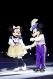 Mickey and Minnie Dressed Up. GREEN BAY, WI - MARCH 10: Mickey and Minnie Mouse in purple outfits and skates at the Disney on Ice Treasure Trove show at the Royalty Free Stock Photo