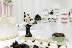 Mickey and Minnie made of marzipan. Surrounded by cakes. Wedding fair in Brasov Business Park 2014 Stock Images