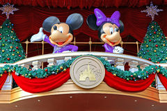 Mickey and minnie mouse christmas decoration. Mickey and minnie mouse with christmas decorations greeting visitors Royalty Free Stock Image