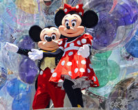 Mickey and Minnie Mouse. An image of major characters at Disney World against a background of balloons Royalty Free Stock Photography
