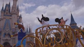 Mickey and Minnie`s Surprise Celebration parade on  cloudy lightblue sky background at Walt Disney World.