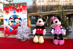 Mickey and Minnie at Xmas Funfair, France. Mickey Mouse and Minnie Mouse sitting on a bench at a Christmas Funfair, France Stock Photography
