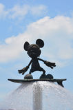 Mickey mouse. Bronze statue of mickey mouse with skate board raised up on the fountain. location : disneyland, hong kong Royalty Free Stock Photography