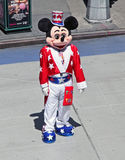 Mickey Mouse. Dressed with the American flag design outfit. He is working in Times Square in NY, waiting for tourists to be photographed with him and expects Stock Photography
