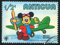 Mickey mouse. ANTIGUA - CIRCA 1980: stamp printed by Antigua, shows Disney Characters, Mickey mouse, plane, circa 1980 royalty free stock image