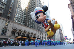 Mickey mouse balloon in Macy's parade. NEW YORK CITY, NY - NOVEMBER 24: Popular Cartoon Character Mickey Mouse during the Macy's 85th Annual Thanksgiving Day Royalty Free Stock Photography