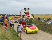 Mickey Mouse Caravan on a Cobblestone Road- Tour de France 2015. Quievy,France - July 07, 2015: Mickey Mouse caravan during the passing of the Publicity Caravan stock photo
