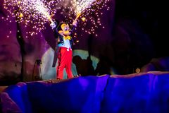 Mickey mouse with fireworks coming out of his hands on Fantasmic Show at Hollywood Studios in  Walt Disney World  2. Orlando, Florida. March 19, 2019. Mickey stock image