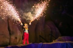 Mickey mouse with fireworks coming out of his hands on Fantasmic Show at Hollywood Studios in  Walt Disney World  1. Orlando, Florida. March 19, 2019. Mickey stock photography