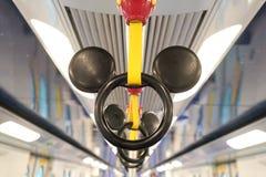 Mickey Mouse handtag i temat för MTR Disney i Hong Kong royaltyfri bild