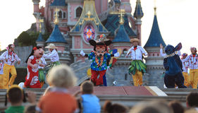 Mickey Mouse and his friends. Paris,France,July 11th 2010: Mickey Mouse and his friends dancing during an evening performance in Disneyland Paris Royalty Free Stock Image