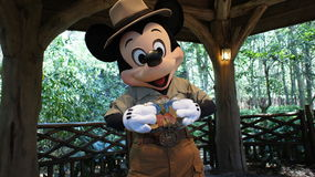 Mickey Mouse holds Flat Stanley Stock Photo