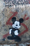 Mickey Mouse. Leon,SPAIN - December 15, 2013: Mickey Mouse smiling Graffiti on a wall street Stock Photos