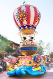 Mickey Mouse and Minnie Mouse riding in a float. Mickey Mouse and Minnie riding on a float waving at people while on a parade royalty free stock photo