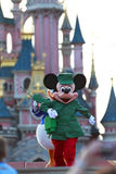 Mickey Mouse running. Towards the audience during an evening performance in Disneyland Paris Royalty Free Stock Photos