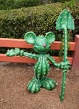 Mickey Mouse statue. Statue of Mickey Mouse in shape of a cactus standing with show shovel in Magic Kingdom Park Disney World in Orlando Florida Stock Photography