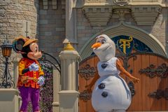 Mickey and Olaf on Mickey`s Royal Friendship Faire on Cinderella Castle in Magic Kingdom at Walt Disney World Resort  . Orlando, Florida. May 17, 2019.  Mickey stock images