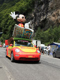 Mickey's car. Beost,France,July 15th 2011: Mickey Mouse's car during the passing of the advertising caravan on the category H climbing route to mountain pass Royalty Free Stock Photos