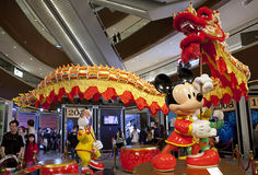 Mickey on traditional chinese clothes. GUANGZHOU, CHINA - FEBRUARY 23, 2015: Mickey is on display at the Disney Stars Exhibition in Taikoo Hui shopping mall. The Royalty Free Stock Photos