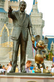 Mickey and Walt statue. Statue of Walt Disney and Mickey Mouse in front of Cinderellas castle in Magic Kingdom, Disneyworld, Florida Royalty Free Stock Images