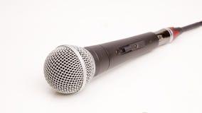 Micrófono aislado en un fondo blanco Foto de archivo libre de regalías