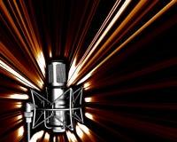 Micrófono con explos ligeros Fotografía de archivo libre de regalías