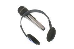 Micrófono con los auriculares Fotos de archivo