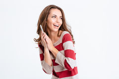 Micrófono de risa de la cubierta de la mujer en el teléfono Fotografía de archivo libre de regalías