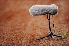 Micrófono en campo de deporte foto de archivo